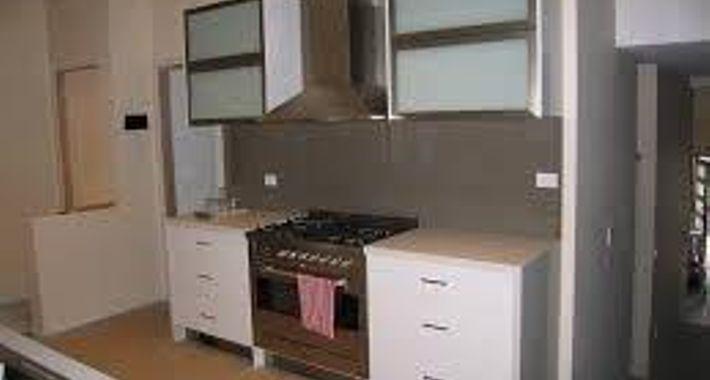 HW Cabinets By Design Logo