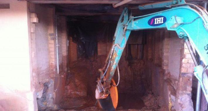 Monster Demolition & Excavation Logo