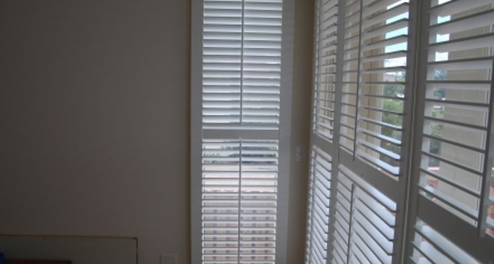 Unique Shutters and Blinds Logo