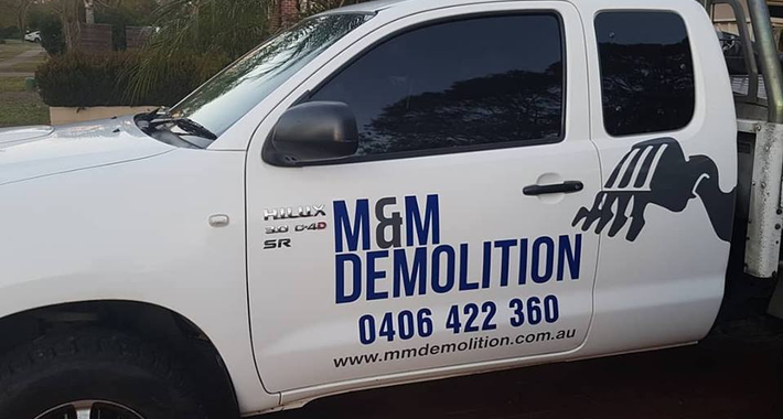 M & M Demolition Logo