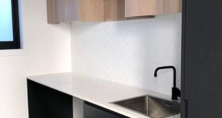 Unique Bath and Kitchens Logo