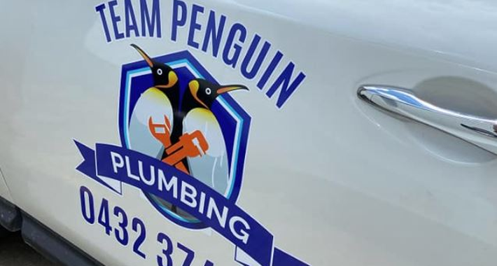 Team Penguin Plumbing Logo