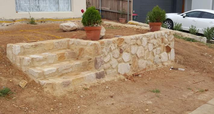 Kosta Dingo & Landscape Builder Logo