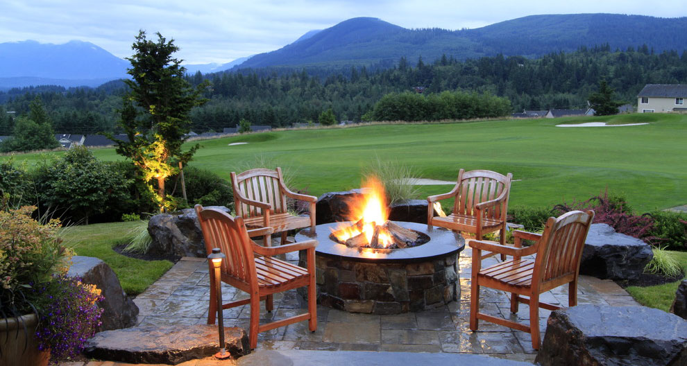 Rustic-inspired campfire seating area.jpg