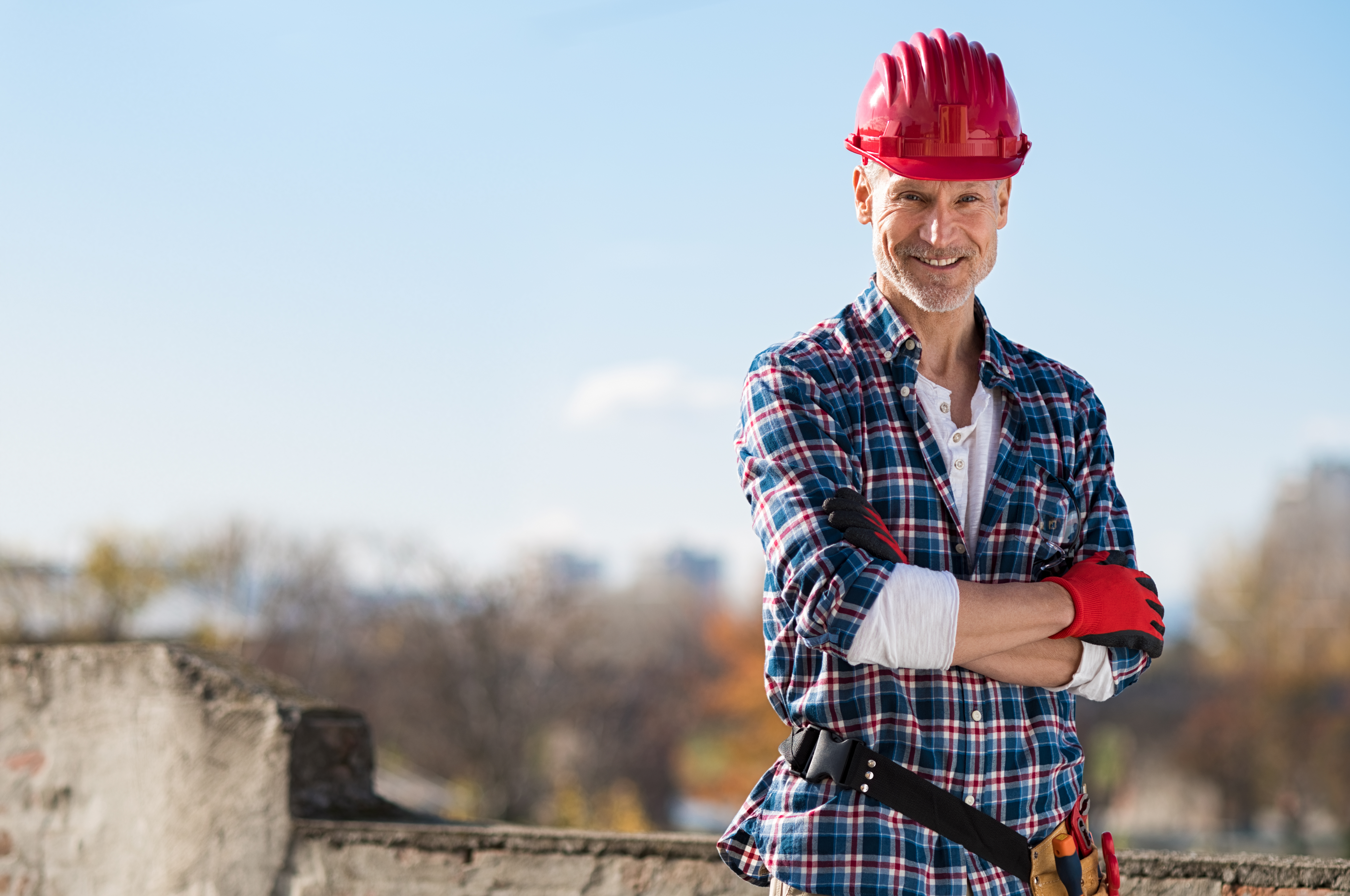tradie with red helmet and blue shirt