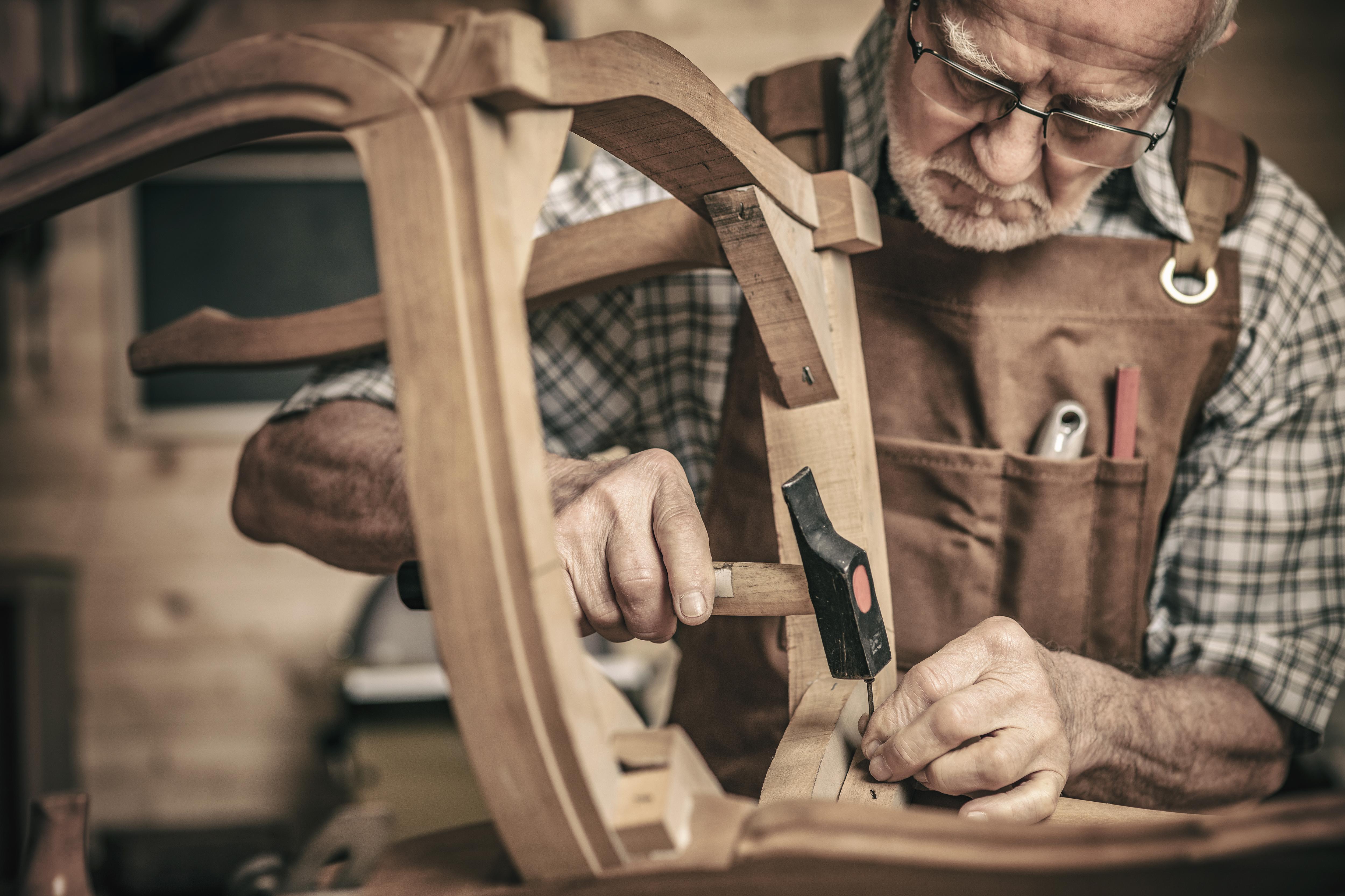 old man doing carpentry work