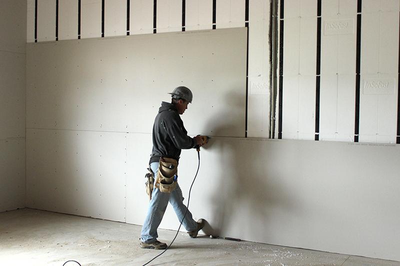 plasterer installing drywall