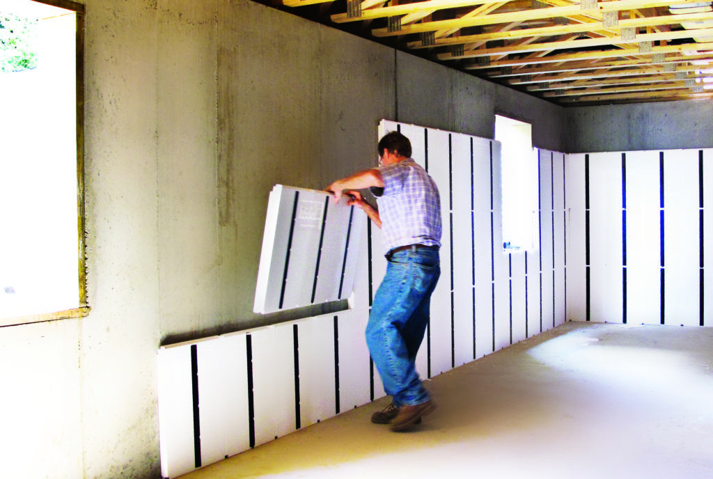 Wall insulation by man in jeans
