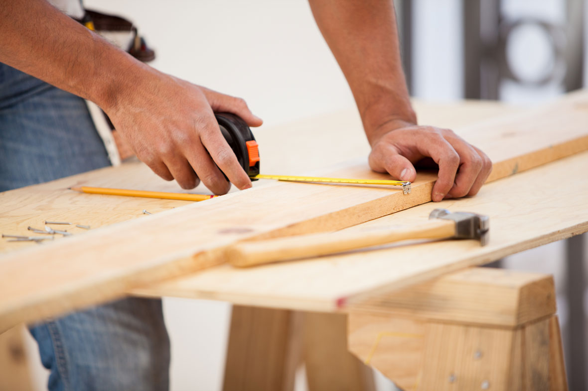 carpenter tools with his hand
