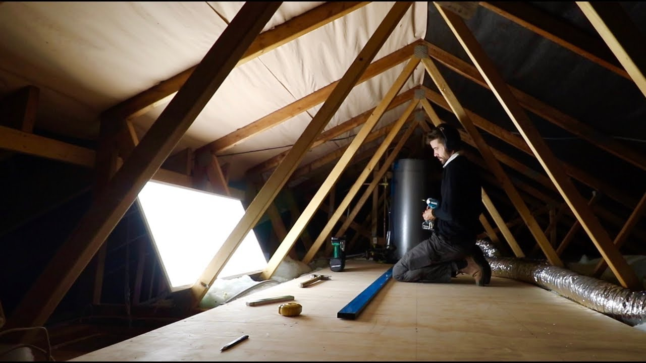 Person in the attic looking for water leaks