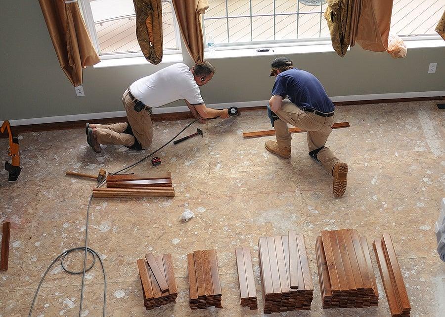 Builders fixing the floor