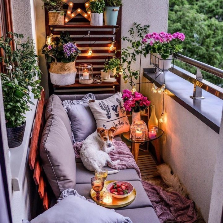 Upcycled balcony with furniture and a dog