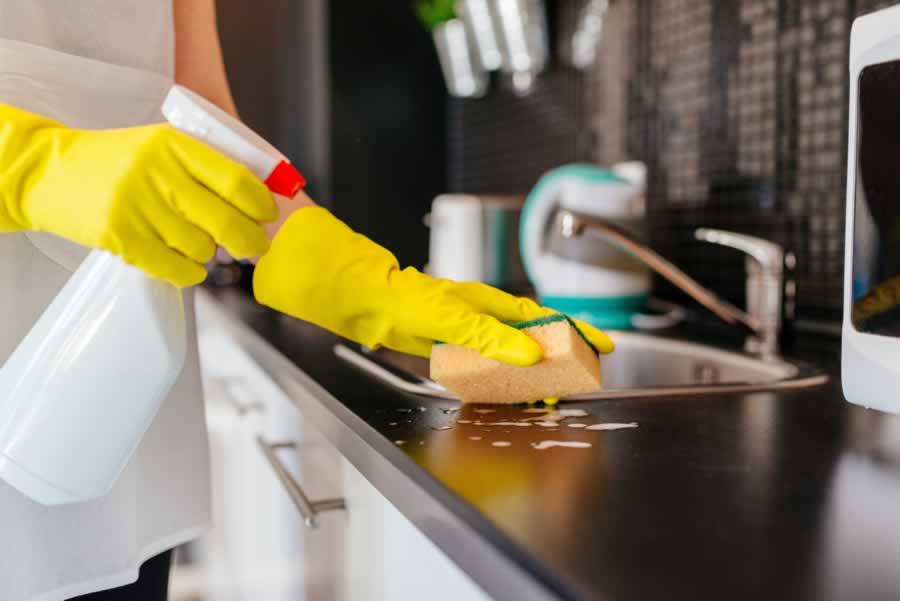 Kitchen cleaning with yellow gloves