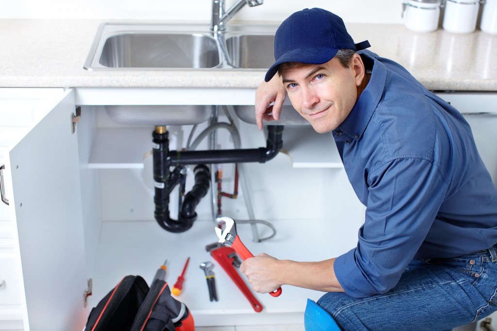 plumber with blue cap