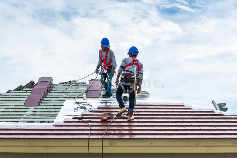 Roofing workers on roof