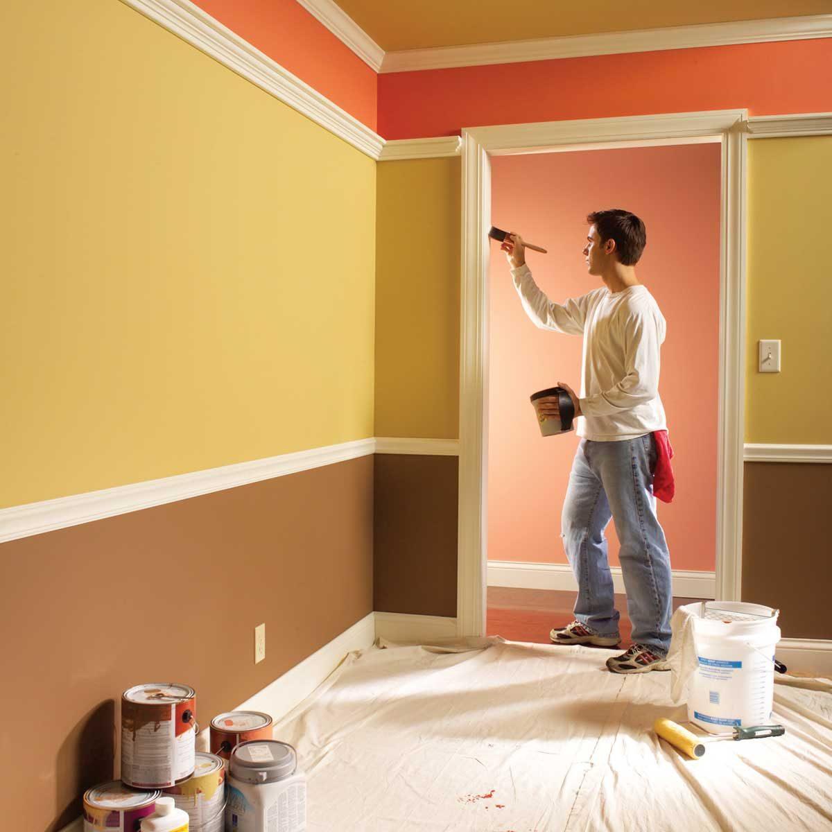man painting a door frame