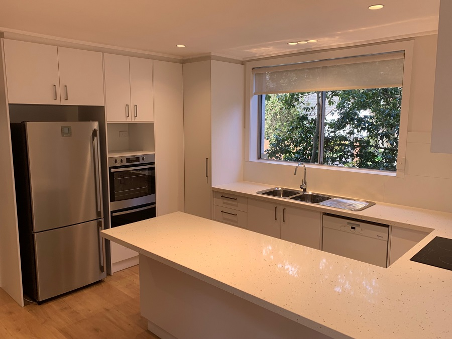 renovated kitchen with dim lighting