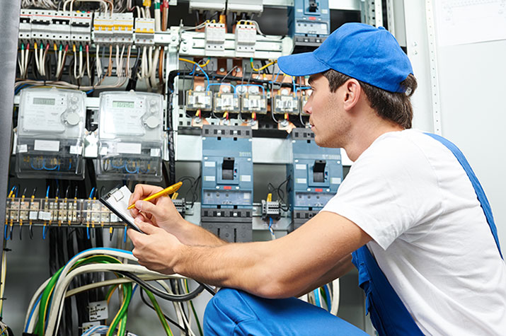 electrician working on a switchboard