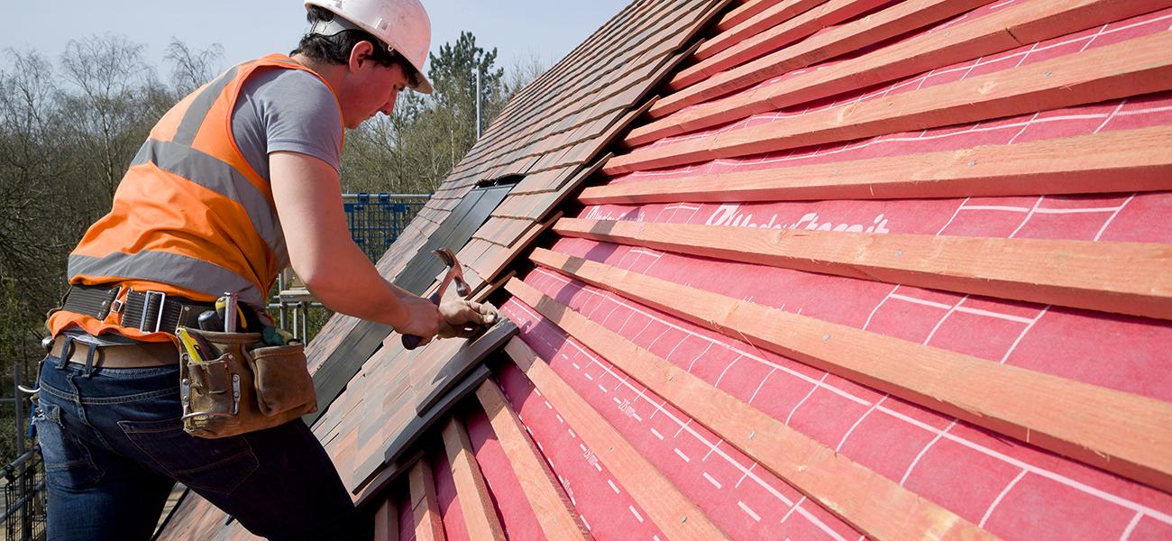 Roofer adding underlay