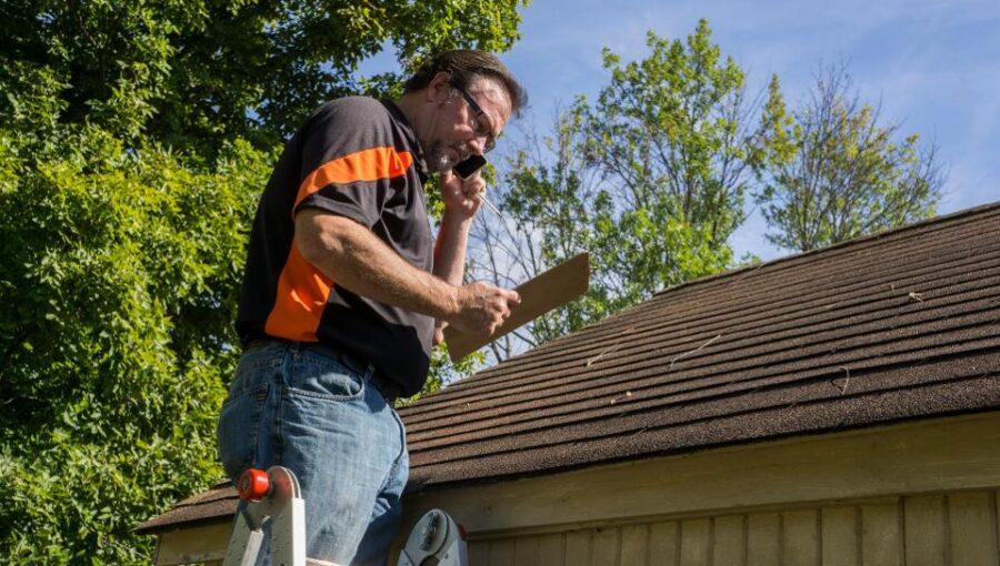 Man repairs hail damage